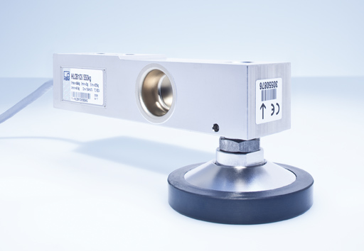 Loading foot simplifies construction of high-precision scales