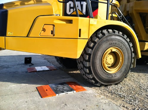 Walz Scale Provides Portable Wheel Weighers for Caterpillar Mining Trucks